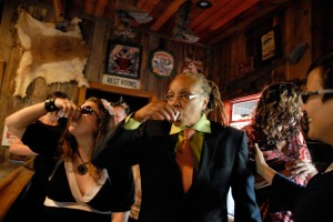 Kim and company do shots right before the wedding in the Red Dog Saloon
