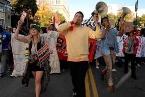 Enthusiastic marching through the streets of Berkeley for OccupyCal Strike
