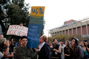 Unjust Capitalist Brutality sign at Sproul Plaza during OccupyCal Strike