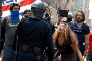 protestor with blue lips confronts policeman