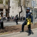 Policeman hit with yellow paint
