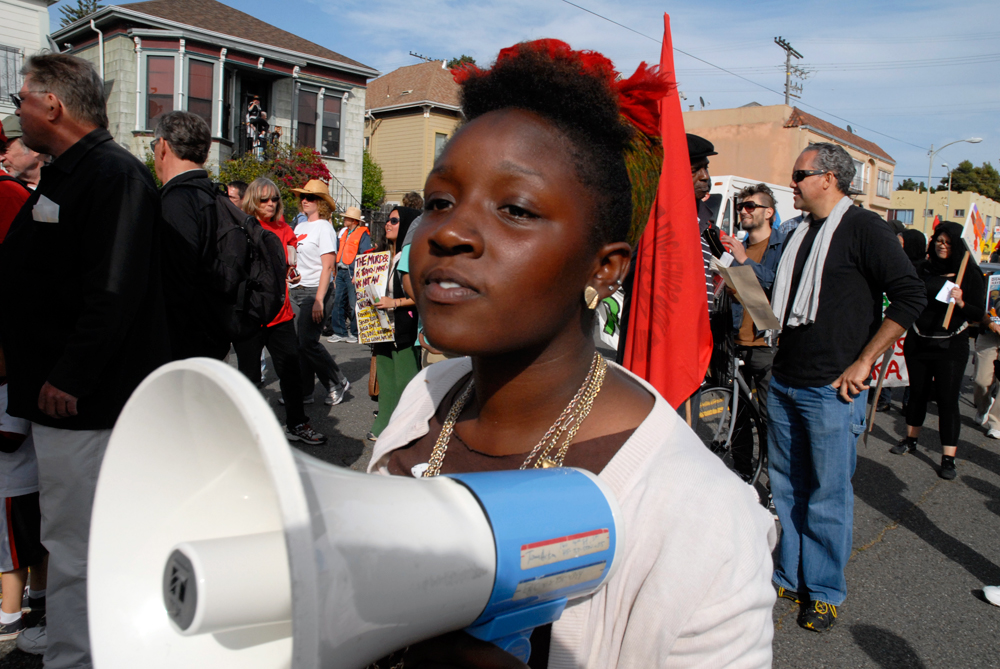 May Day March in Oakland - woman with megaphone