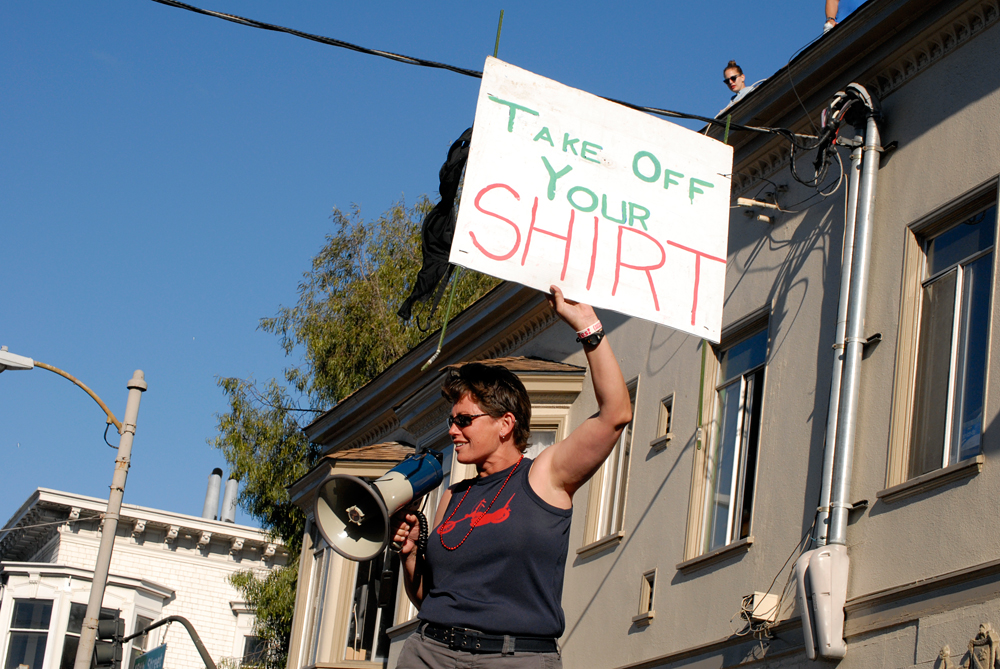 Take Off Your Shirt signage along Dyke March route